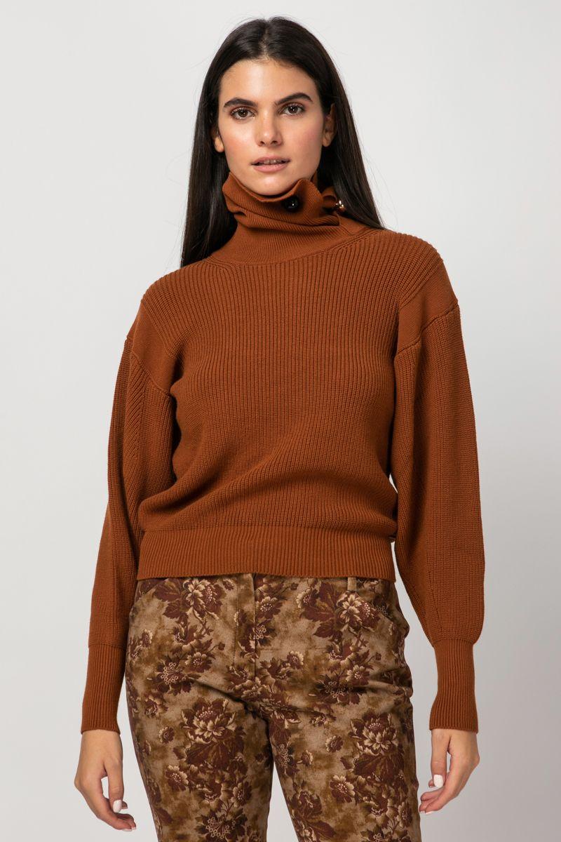 Turtleneck blouse embellished with brooch