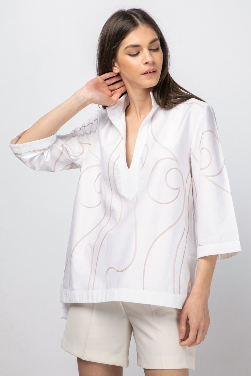 White blouse with pink-gold embroideries