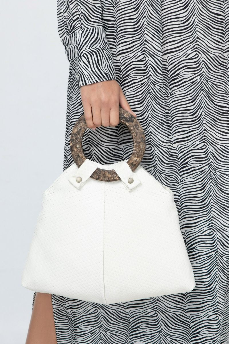 Curved leather bag