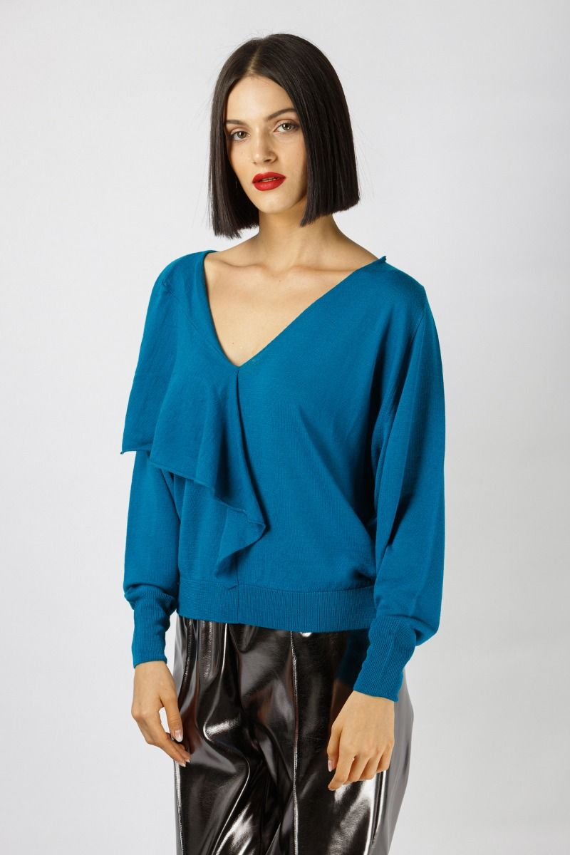 Knitted blouse in vibrant turquoise color