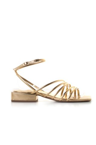 Flat golden sandals with strips and ankle strap