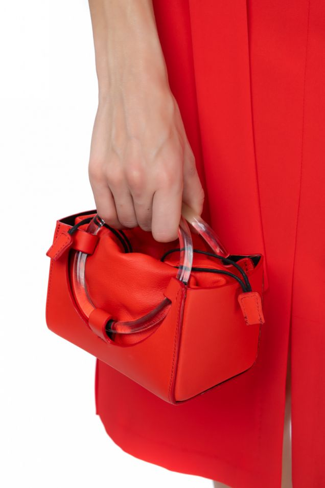 Mini bag with plexi-glass handle