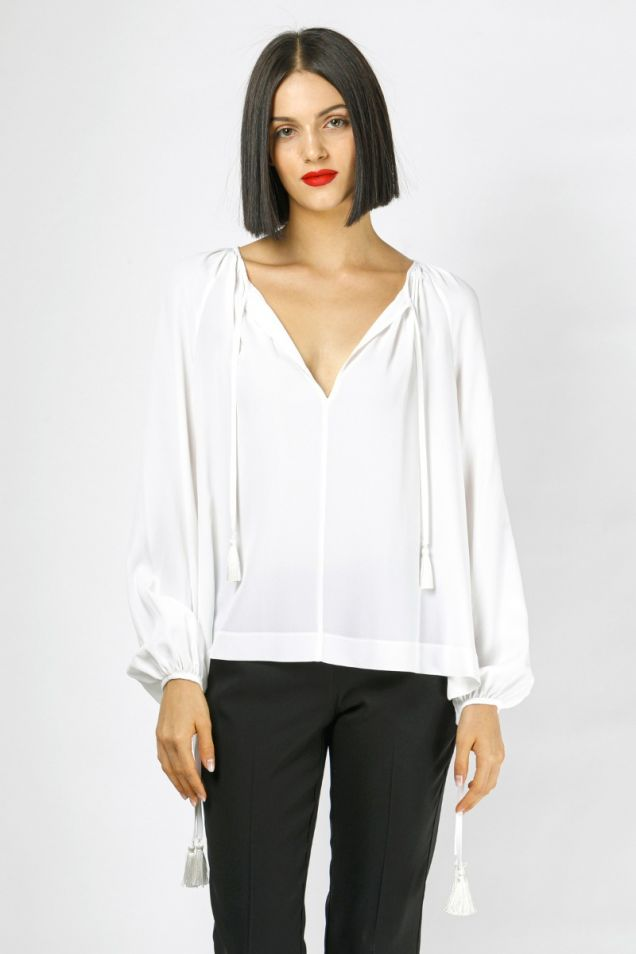 Blouse in white color, embellished with tassels