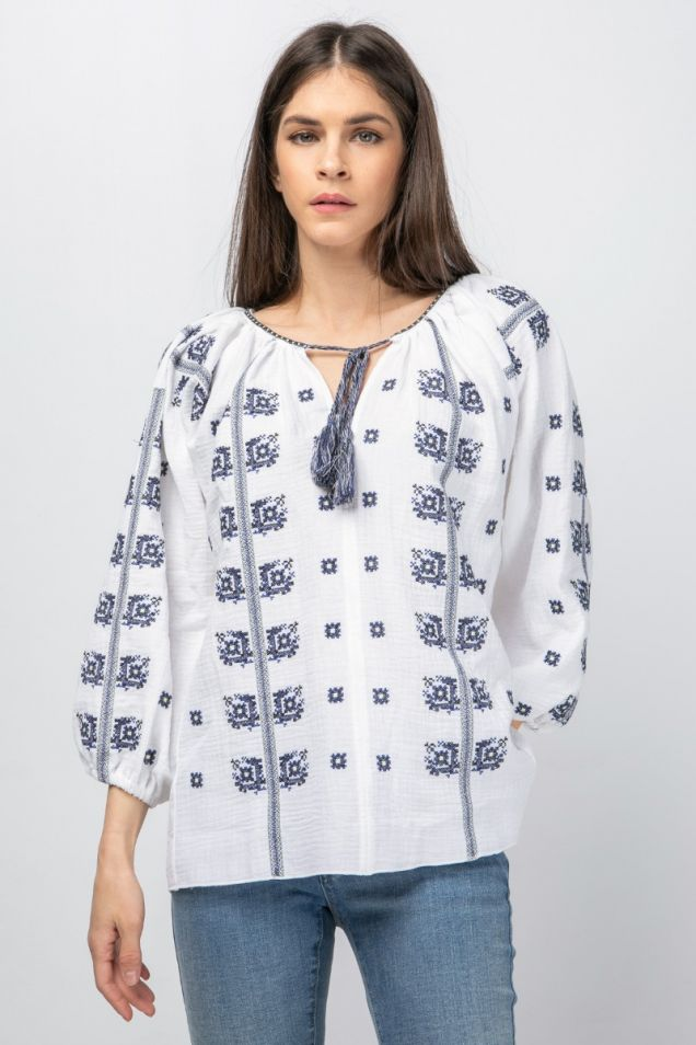 White blouse with blue embroideries