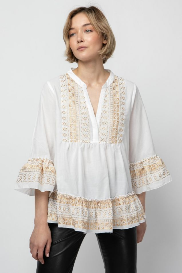 White blouse with gold embroidery