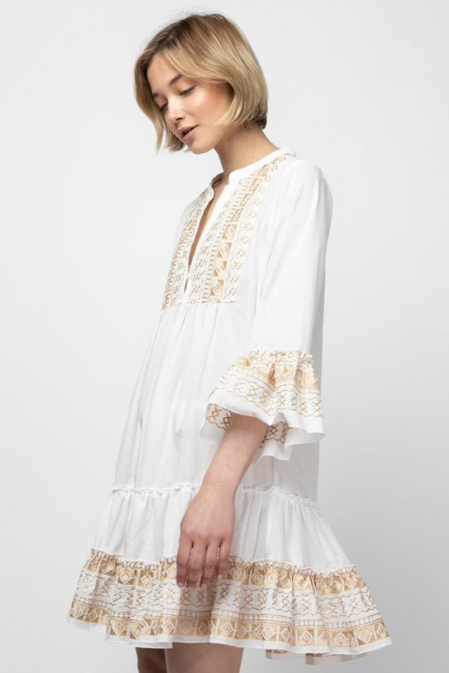 Dress in white with gold embroidery