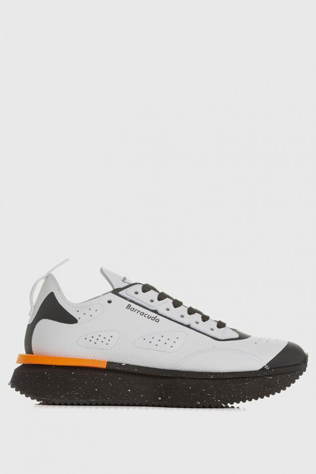 White sneakers with black and orange details