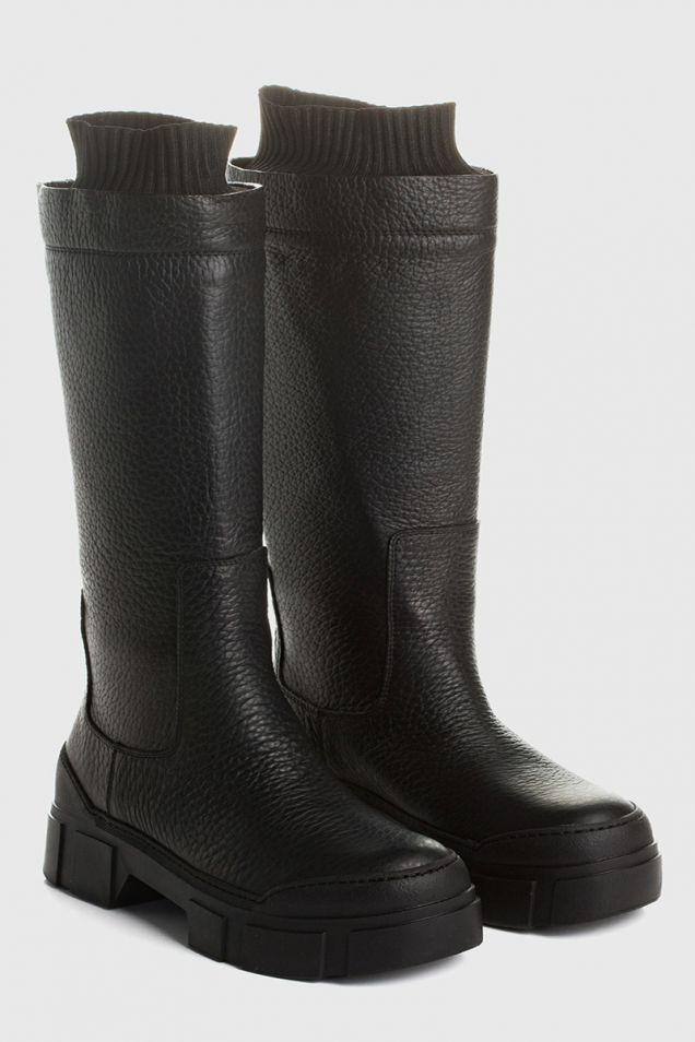 Black leather tube boots with cuffs and lugged sole