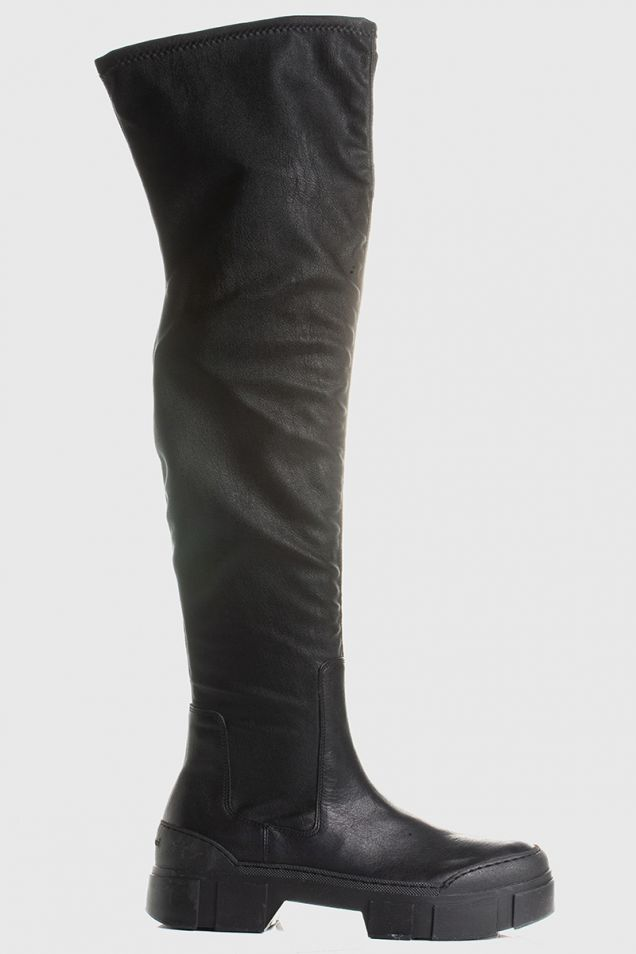 Black thigh-high boots in black leather/faux leather with lugged sole