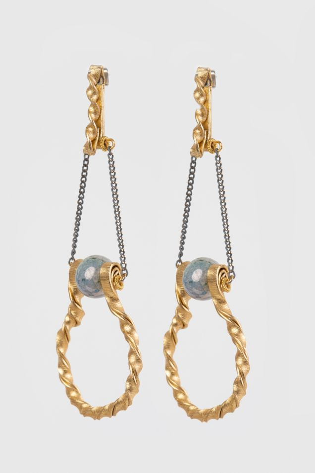 Gold-tone earrings with a grey bead